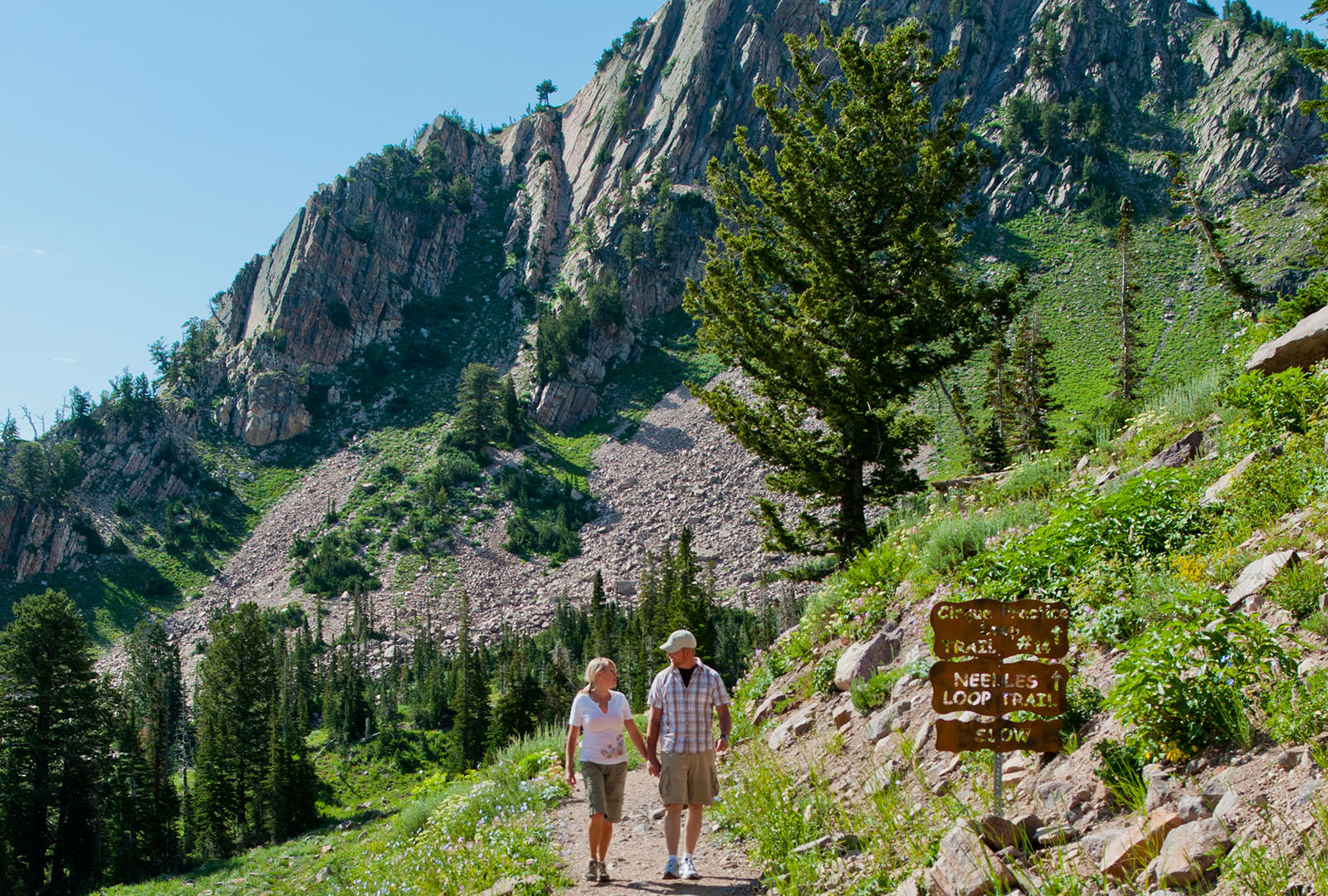 Man and woman hiking in the mountains at Snowbasin