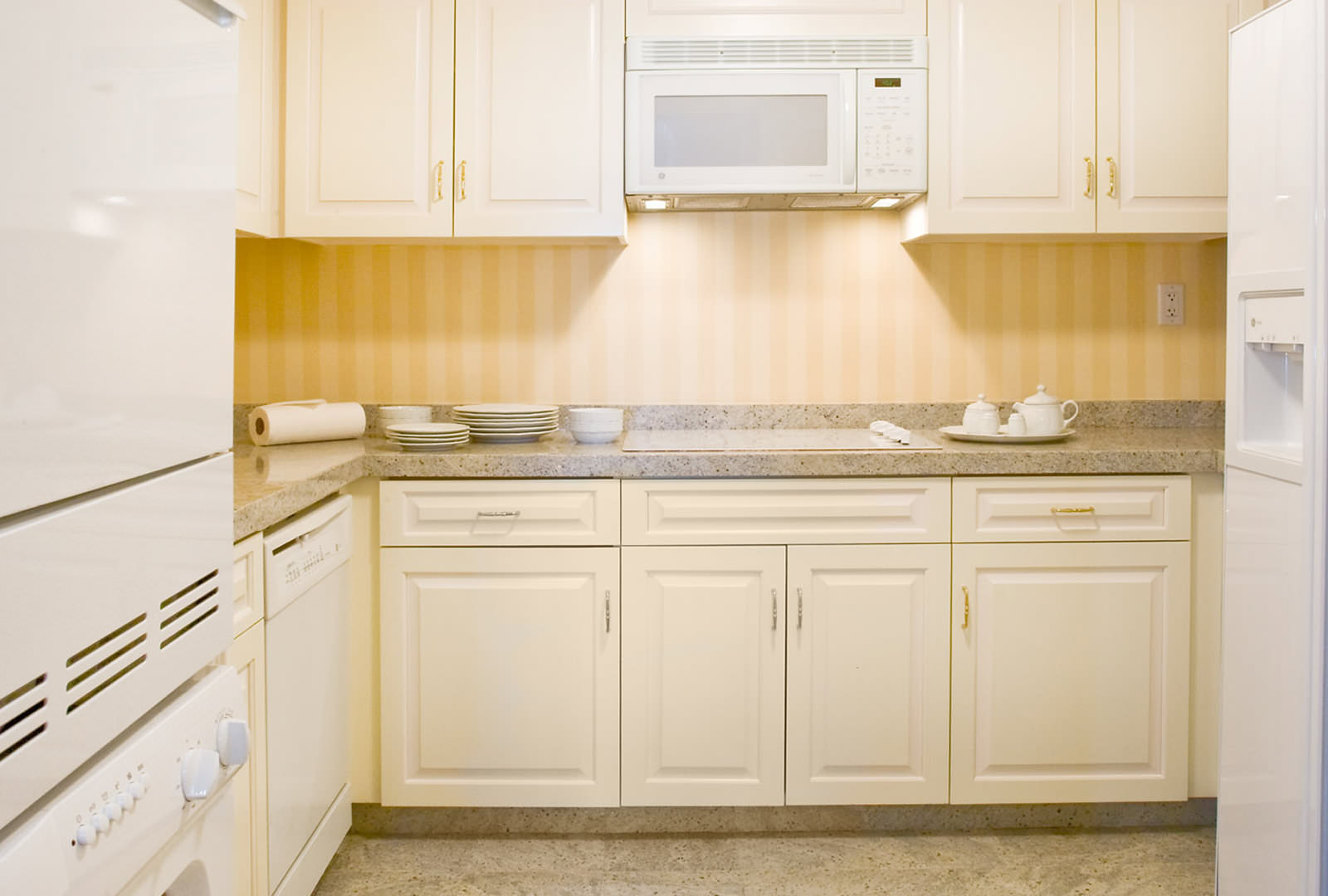 Grand America Hotel kitchen suite with white cabinets and white appliances