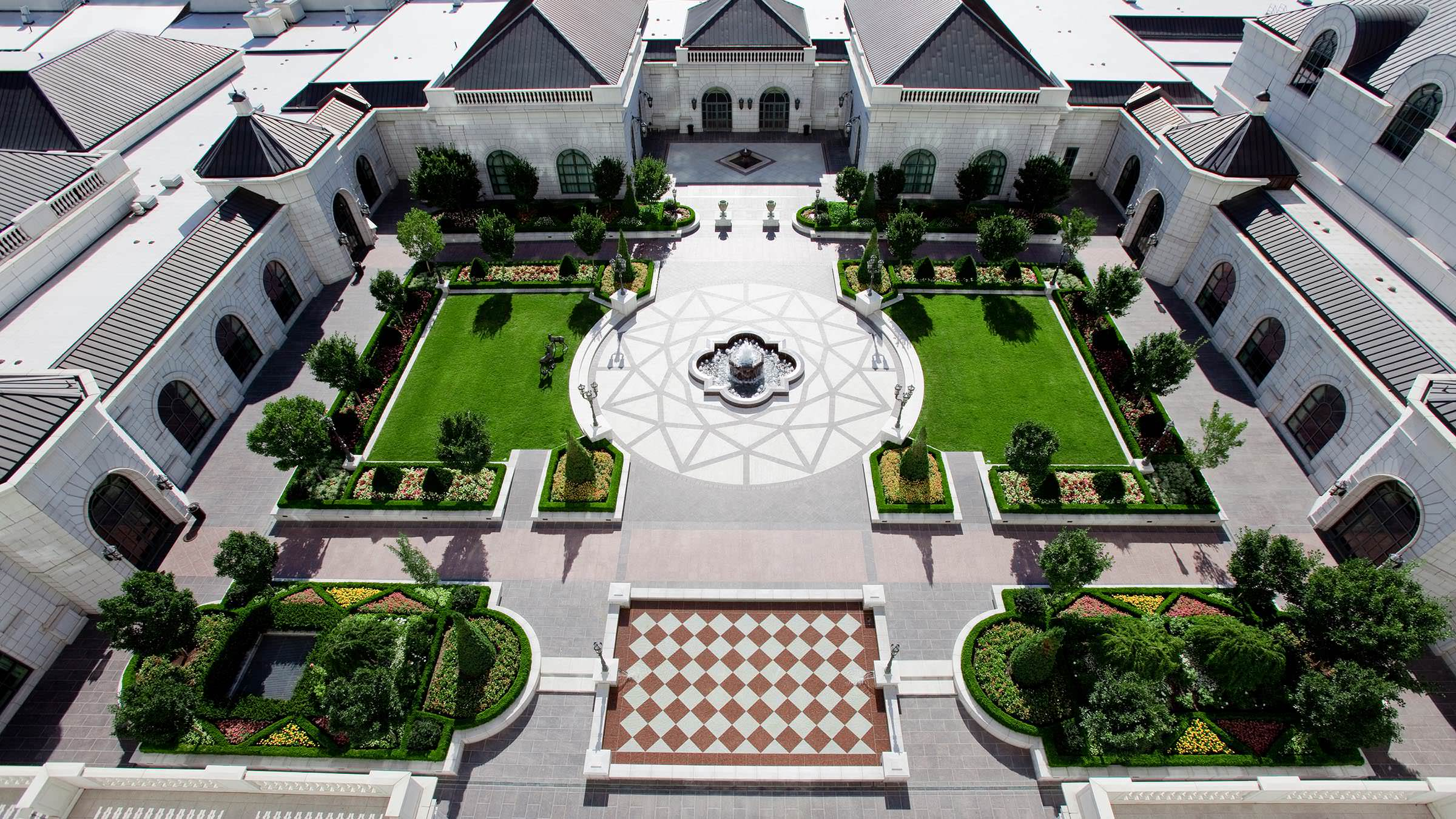 Grand America Hotel's Center Courtyard with green manicured lawns and fountain.