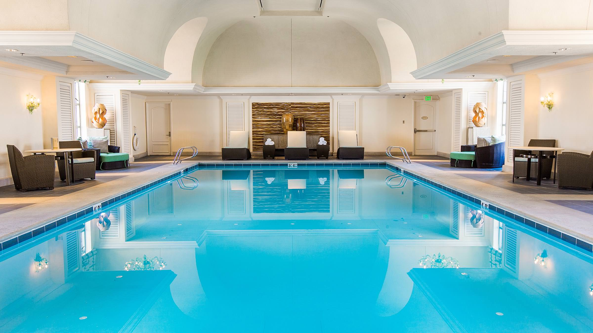 The Grand Spa's Indoor Pool featuring arched ceilings and Italian chandeliers.