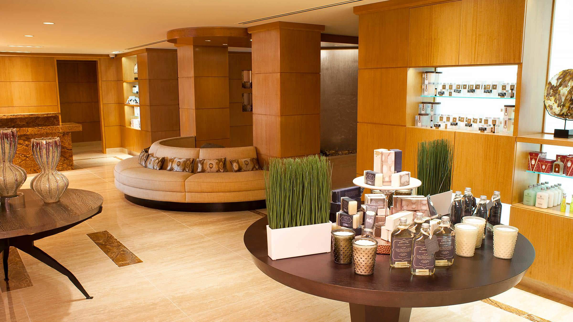 Grand Spa retail space with waiting area, water feature, and spa products.