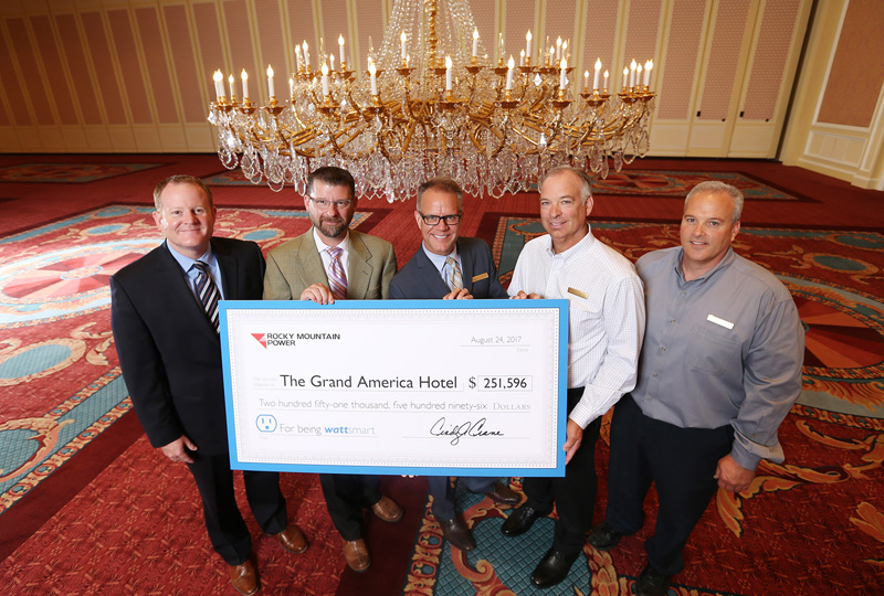Rocky Mountain Power wattsmart project team in The Grand Ballroom at The Grand America Hotel celebrating the completion of a recent energy project.