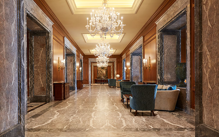 The Grand America Hotel main lobby with marble flooring and chandeliers