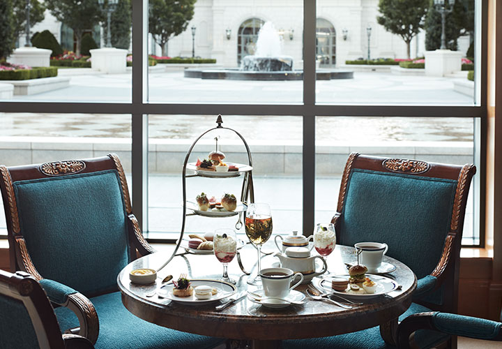 Afternoon Tea in the Lobby Lounge at The Grand America featuring dainty finger sandwiches, sweet treats, scones, and unique teas.