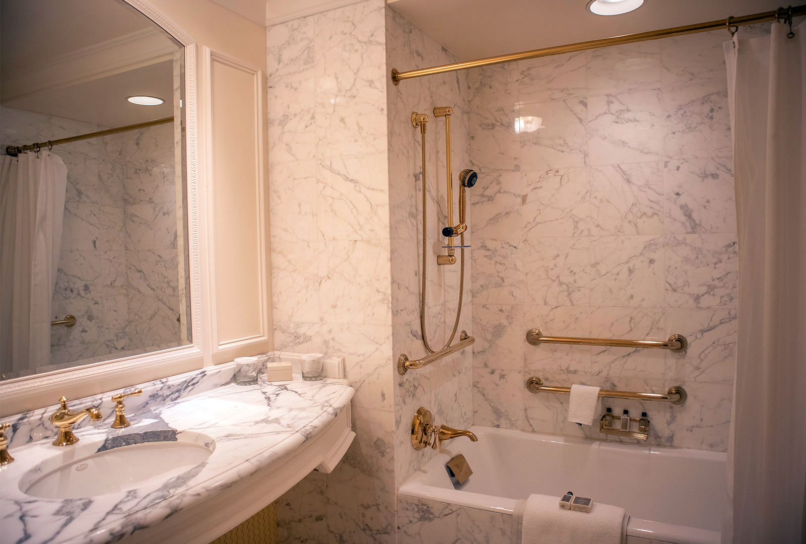 Guest Bathroom with Marble Sink and Bathtub with ADA Rails