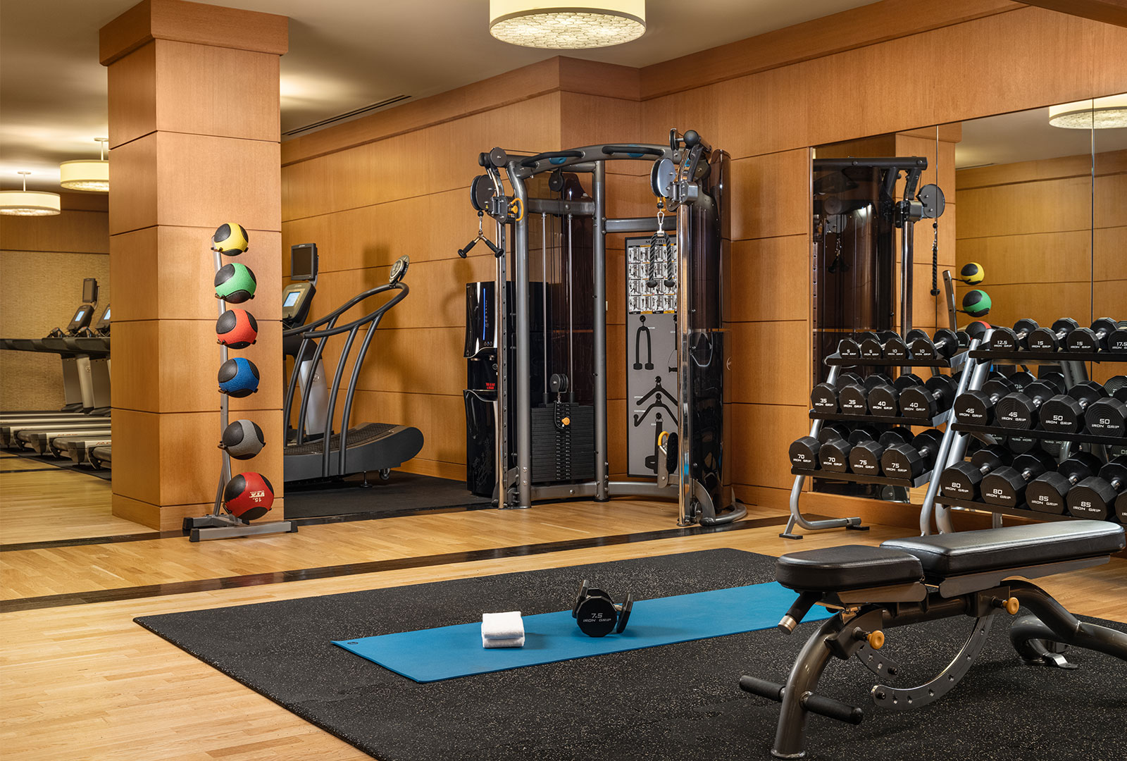 Grand America's Fitness Center featuring cardio equipment, free weights, and strength training stations.