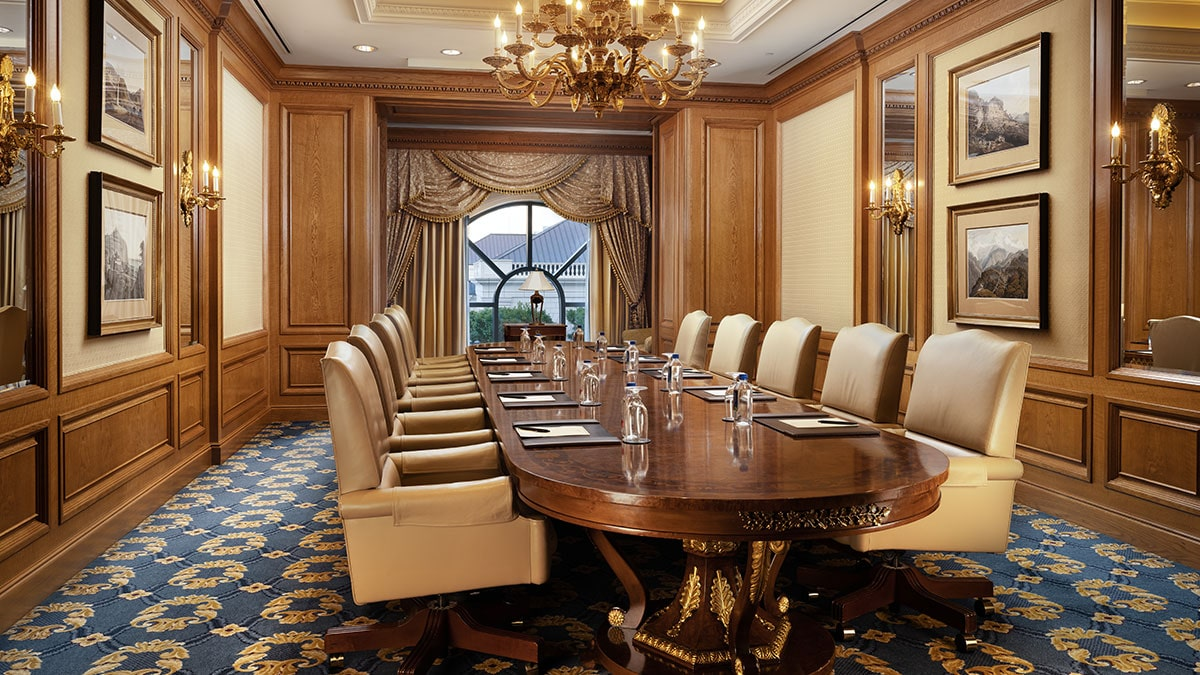 Embassy boardroom at the Grand America Hotel with a custom Italian board table and a view of the Center Courtyard.