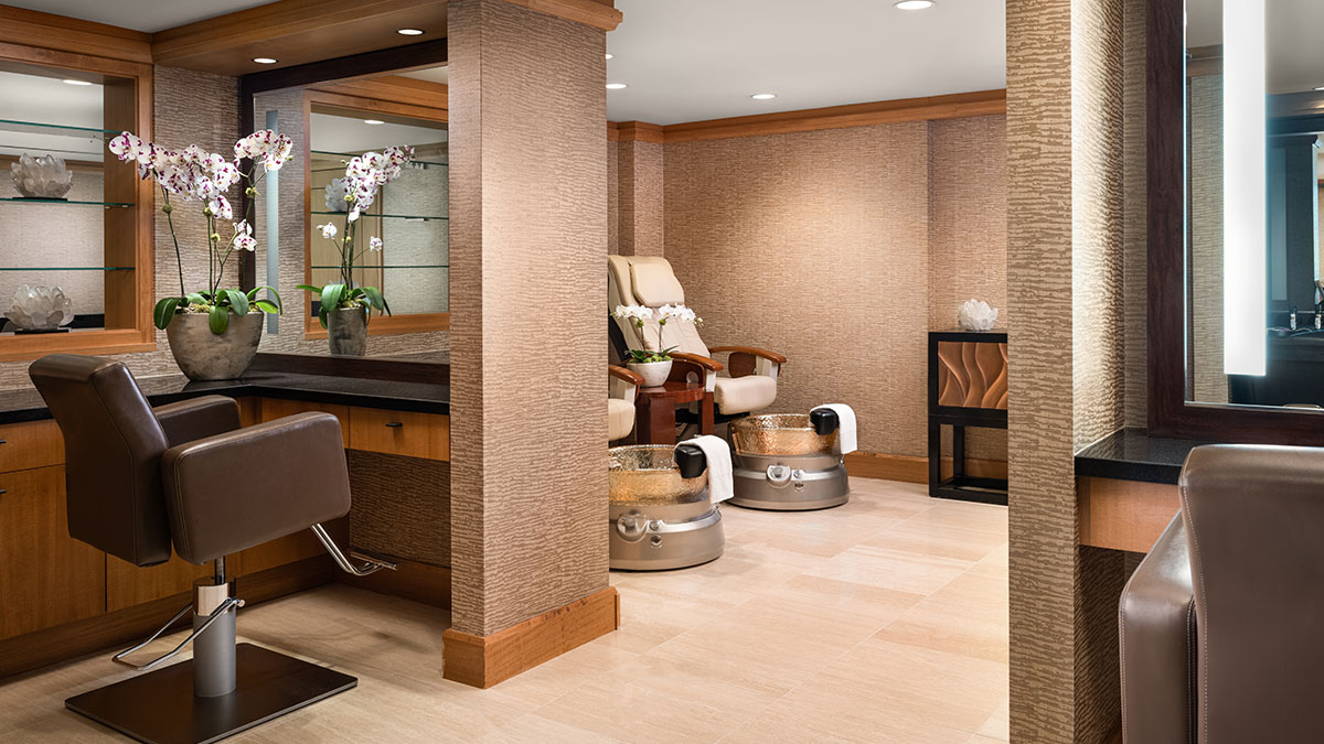 Grand Spa's Salon featuring massage pedicure chairs.