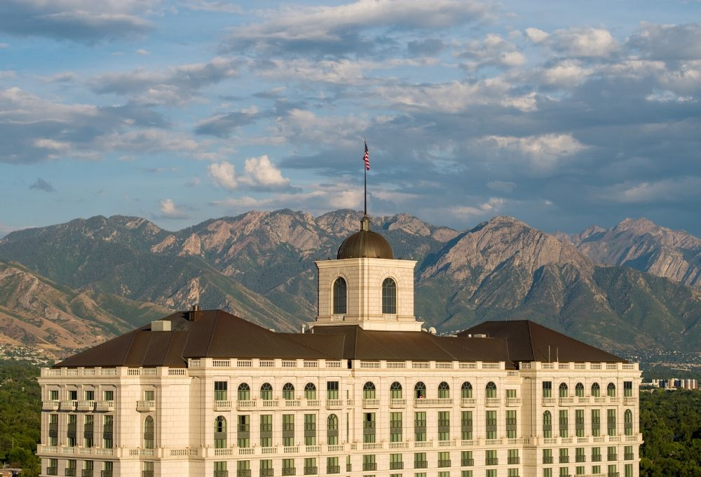 The top of The Grand America Hotel with the Wasatch Mountains