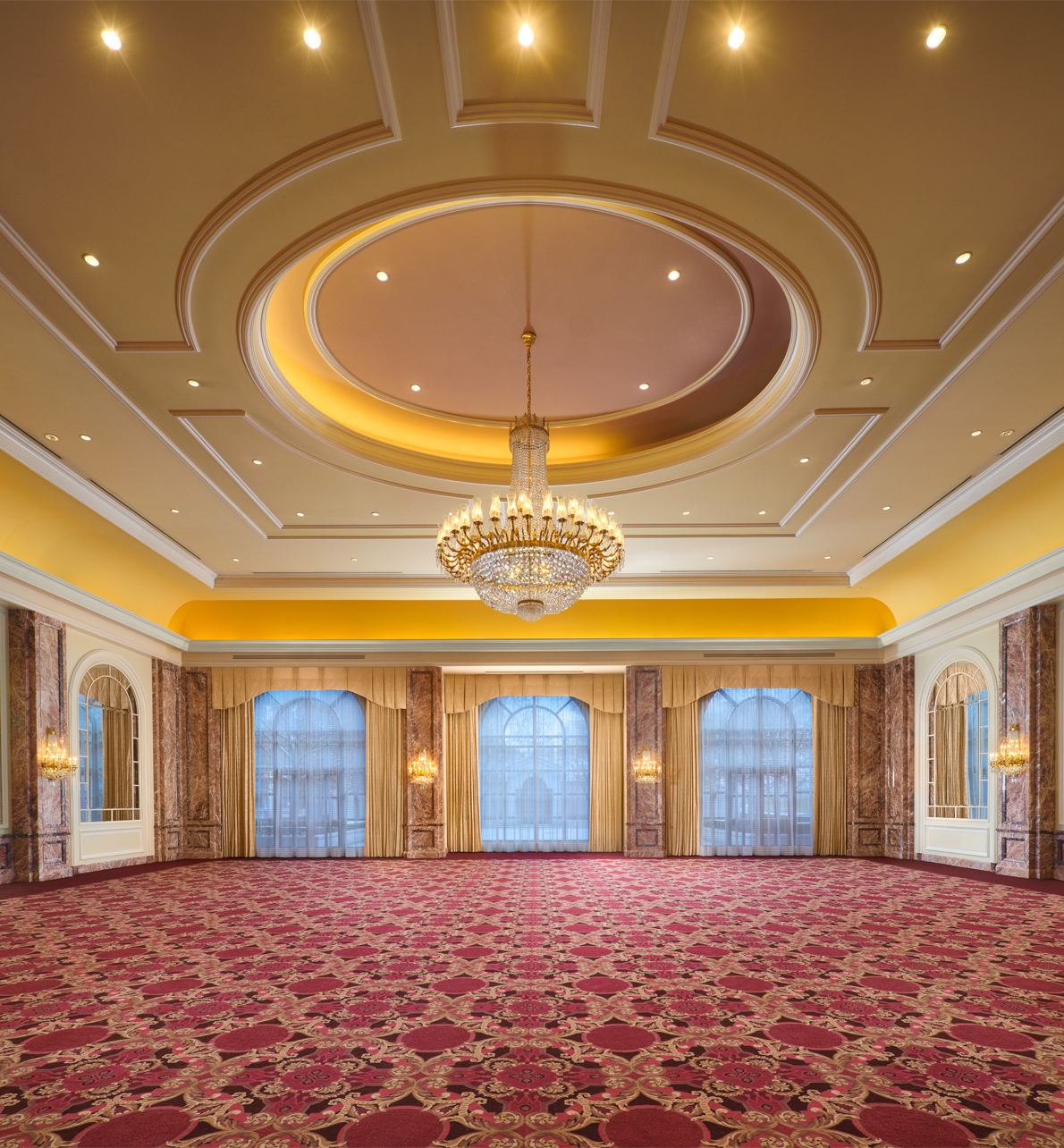 The Grand Salon meeting space with a large center chandelier at the Grand America Hotel